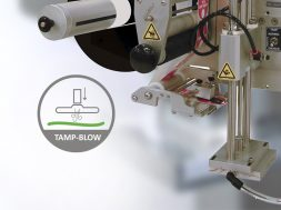 Tamp-Blow label application method